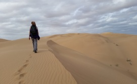Marie Long hiking a sand dune. Photo: ASDM/Amy Orchard