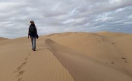Marie Long hiking a sand dune. Photo: ASDM/Amy Orchard